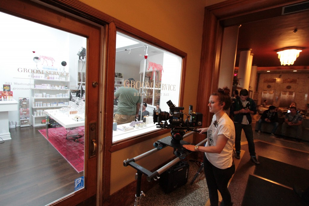 Camera Operator Shannon Madden sets up a shot outside of Groom Service in the Hotel @ Lafayette.